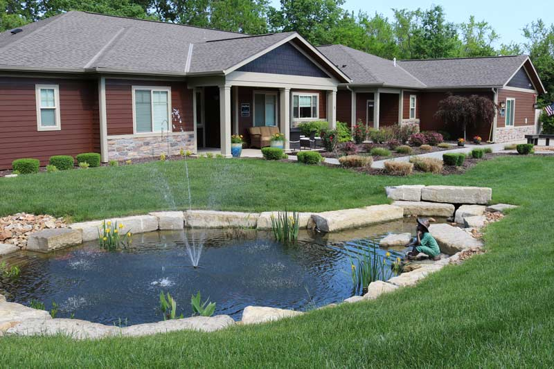 A Bridge Haven residence with a beautifully landscaped pond in the yard